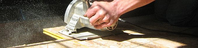 Person Using Hand Saw