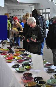 Empty Bowls Participant Picking Bowl