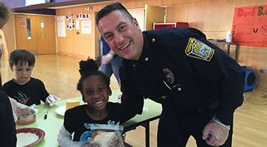 Police Officer Reynolds and a child
